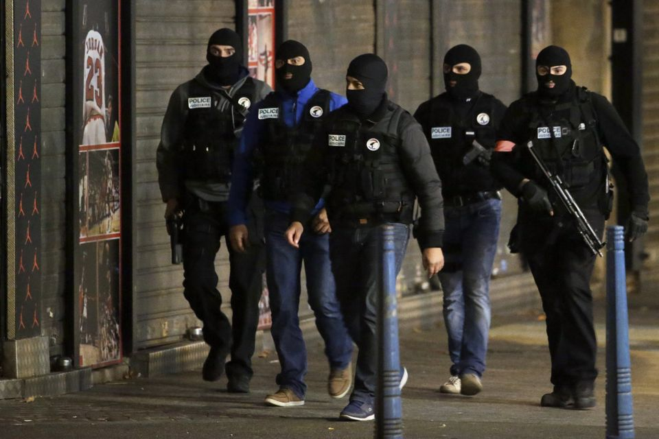 Members of a special intervention unit of the French police patrol in the northern Paris suburb of Saint-Denis on Nov. 18, 20