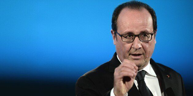 French President Francois Hollande delivers a speech during a meeting with elected representatives of the County Council of o