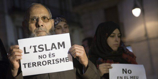 BARCELONA, SPAIN - NOVEMBER 16: Muslims from Barcelona gather to condemn Friday terror attacks in Paris by holding posters at