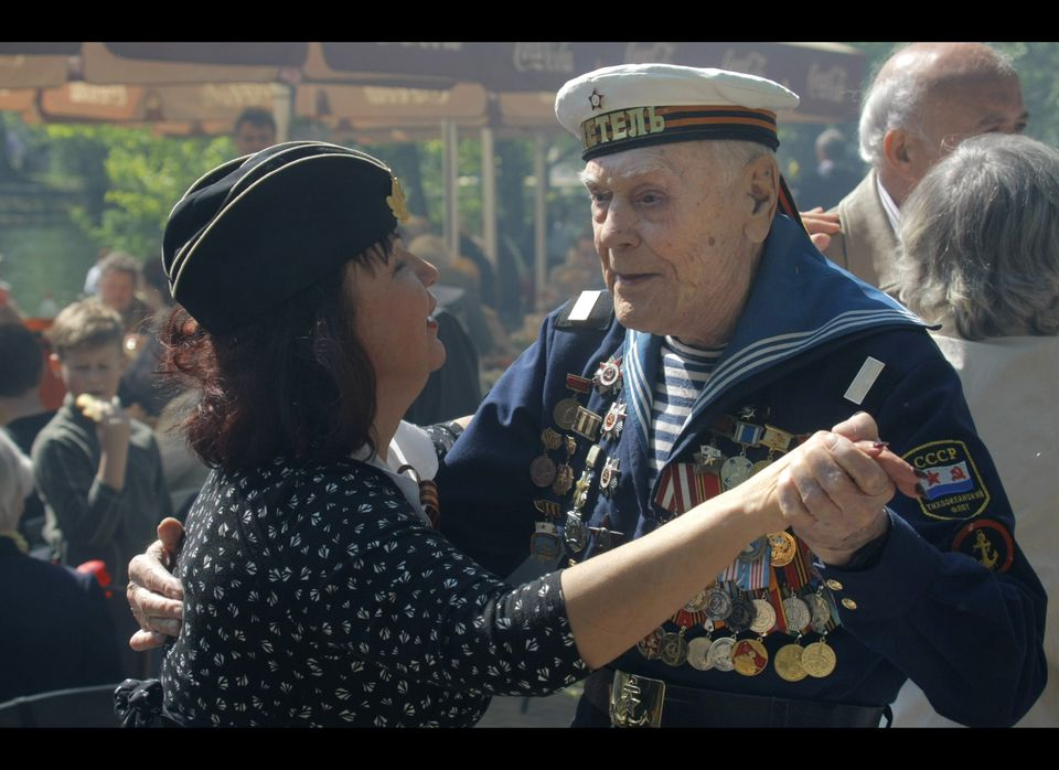 Russian World War II veteran Yuri Fomichev, 86, dances as celebrates Victory Day of the 66th anniversary of the allied victor