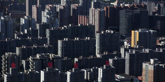 Residential buildings stand in Beijing, China, on Monday, Sept. 8, 2014. China is scheduled to release figures on consumer an