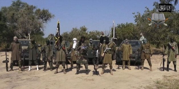 FILE - In his file image taken from video released late Friday evening, Oct. 31, 2014, by Boko Haram, Abubakar Shekau, centre