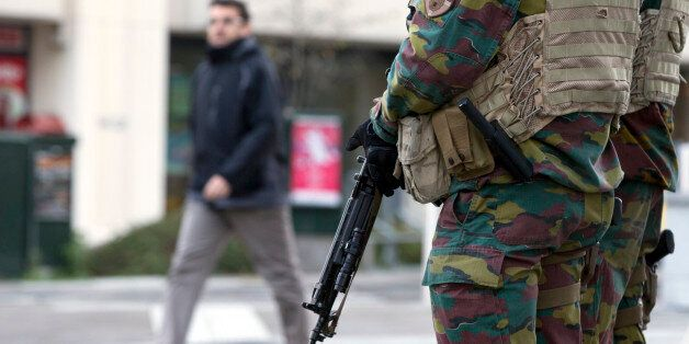 Belgian Army soldiers patrol outside EU headquarters in Brussels on Monday, Nov. 23, 2015. The Belgian capital Brussels has e