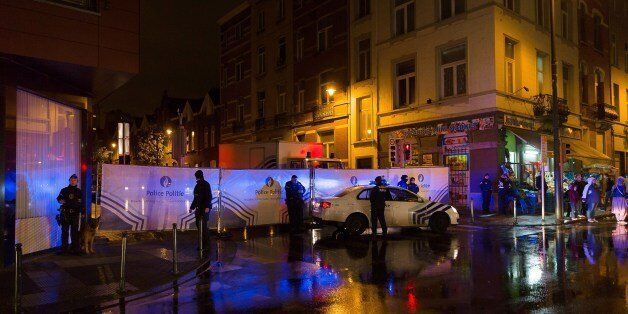 Belgian police cordon off a street during a police raid in connection with the November 13 deadly attacks in Paris, in Brusse