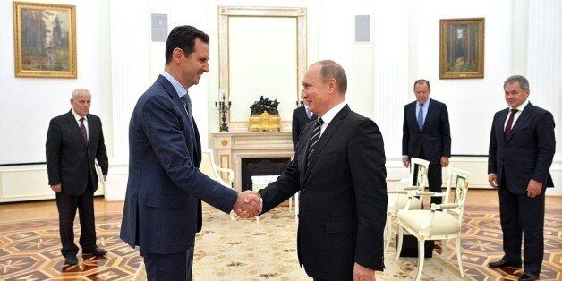MOSCOW, RUSSIA - OCTOBER 21: Syrian President Bashar al-Assad (L-2) meets with Russian President Vladimir Putin (R-3) at the