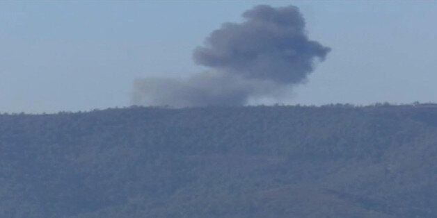 This frame grab from video by Haberturk TV, shows smoke from a Russian warplane after crashing on a hill as seen from Hatay p