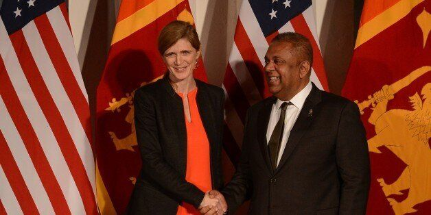 United States Ambassador to the United Nations Samantha Power (L) shakes hands with Sri Lanka's Foreign Minister Mangala Sama