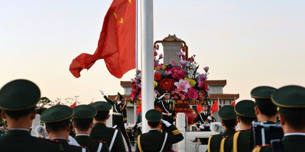 BEIJING, CHINA - OCTOBER 01: (CHINA OUT) Flag-bearers walk toward the platform to raise the Chinese national flag in the morn