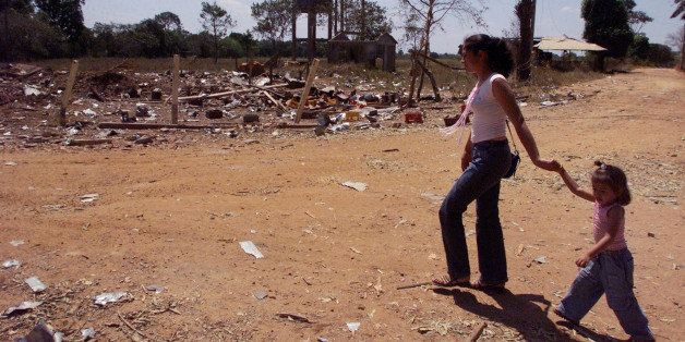 Residents walk amid the remains of La Union, 100 miles southeast of Villavicencio,  Colombia, in this Jan. 21, 2003 photo, af