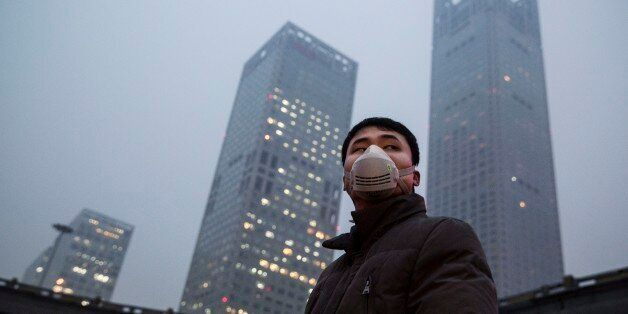 BEIJING, CHINA - DECEMBER 08: A Chinese man wears a mask to protect against pollution in heavy smog on December 8, 2015 in Be