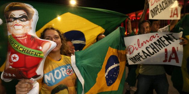 People demonstrate against the government as they take part in protest in favor of the impeachment of Brazil's President Dilma Rousseff, in front of the National Congress, in Brasilia, Brazil, Wednesday, Dec. 2, 2015. Impeachment proceedings were opened Wednesday against Brazilian President Rousseff by the speaker of the lower house of Congress, a sworn enemy of the beleaguered leader. (AP Photo/Eraldo Peres)
