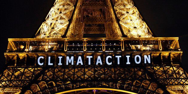 PARIS, FRANCE - DECEMBER 11:  The slogan 'Climat action' is projected on the Eiffel Tower as part of the World Climate Change