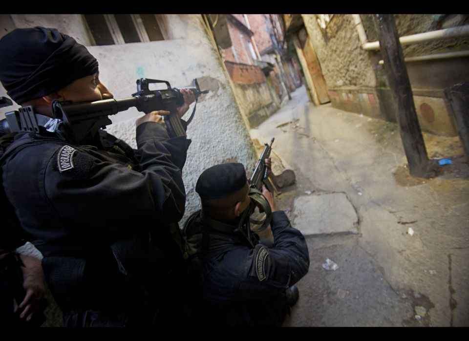 Members of Brazil's special police unit BOPE take positions in a raid of the Mangueira slum in Rio de Janeiro, Brazil, Sunday