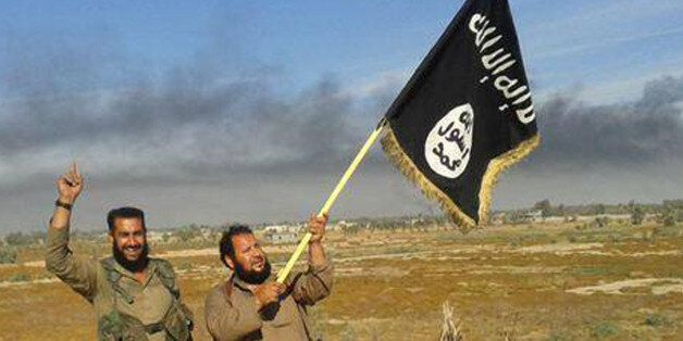 FILE - In this file photo released on Sunday, June 28, 2015, by a website of Islamic State militants, an Islamic State milita