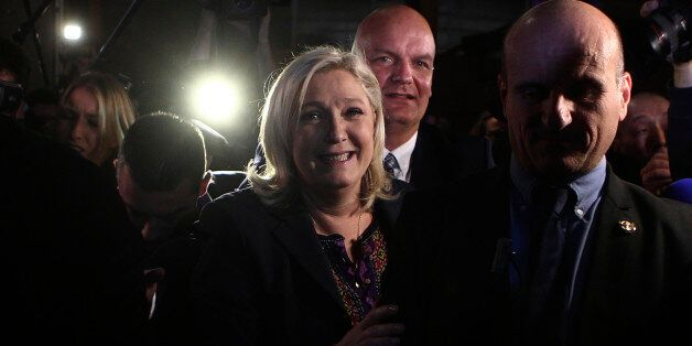 Far Right National Front party leader Marine Le Pen leaves after the second round of the regional elections in Henin-Beaumont