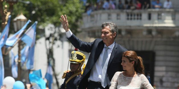 BUENOS AIRES, ARGENTINA - DECEMBER 10:  President of Argentina Mauricio Macri and his wife Juliana Awada greet the crowdd as
