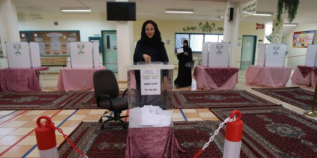 JEDDAH, SAUDI ARABIA- DECEMBER 12:  Saudi women cast their votes for the municipal elections at a polling station on December
