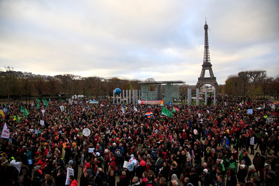 Activists gather near the Eiffel Tower, in Paris, Saturday, Dec.12, 2015 during the COP21, the United Nations Climate Change