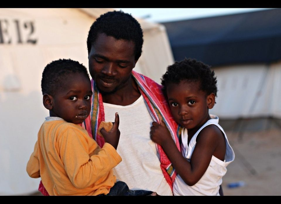 "John Osas, 32, with his children, lost two Nigerian friends when the ship they were on capsized on June 1, 2011. ""I will neve"