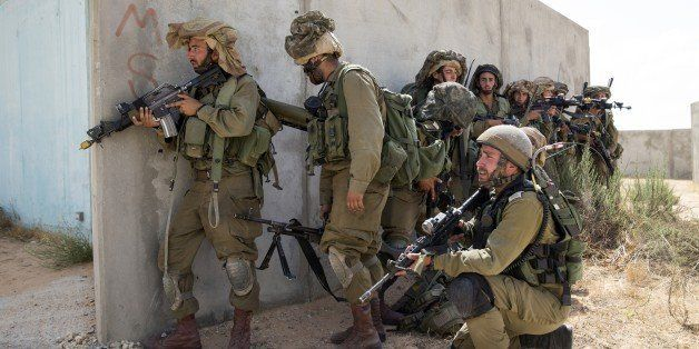 Israeli army soldiers take part in training at the Urban Warfare Training Centre (UWTC) in Tse'elim camp in southern Israel o
