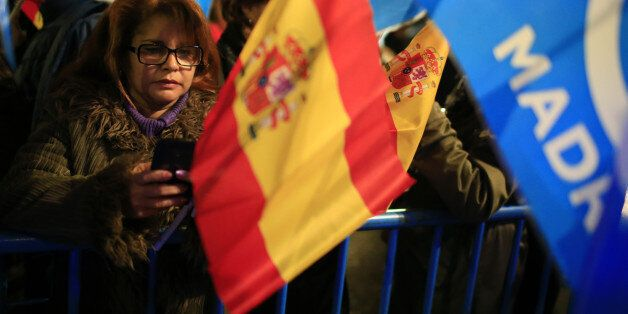People's Party (Partido Popular) supporters wait for the results during the Spanish general election outside the party's head