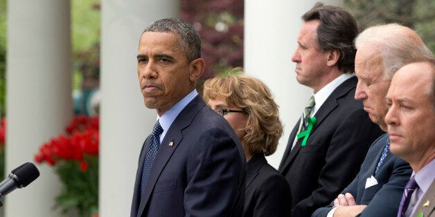 President Barack Obama frowns as he speaks during a news conference in the Rose Garden of the White House, in Washington, on