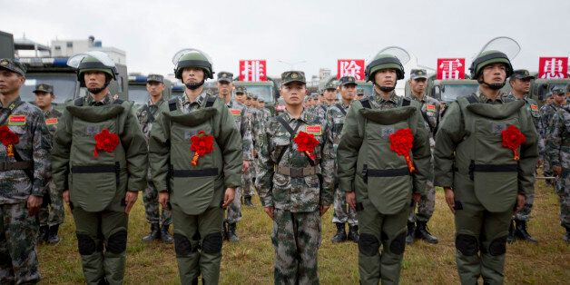 WENSHAN, CHINA - NOVEMBER 03: (CHINA OUT) PLA soldiers attend a rally to star the mine clearance mission on the border with V