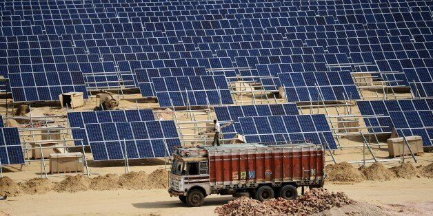 TO GO WITH: Climate-warming-COP21-India-energy-solar, FOCUS by Annie Banerji In this photograph taken on August 23, 2015, an