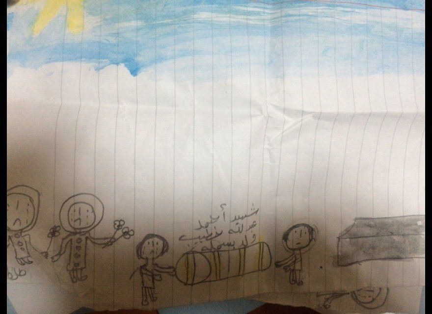 In this drawing, Basmallah recalls her father's funeral. She draws her family gathered around his coffin.