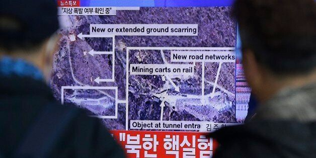 People watch a TV screen showing the news reporting about an earthquake near North Korea's nuclear facility at the Seoul Rail