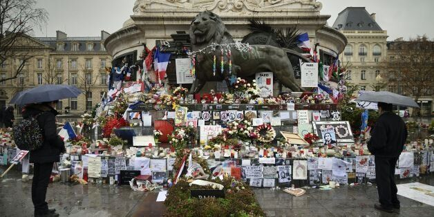 TOPSHOT - A picture taken on January 7, 2016 shows a makeshift memorial for the victims of Paris attacks at the Place de la R