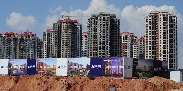 Empty apartment developments stand in the city of Ordos, Inner Mongolia on September 12, 2011.  The city which is commonly re