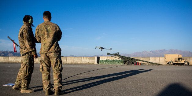 FOB SHANK, LOGAR PROVINCE - MAY 8: Two U.S. Army soldiers launch a 14' Shadow Unmanned Aerial Vehicle, or UAV, from an airstr