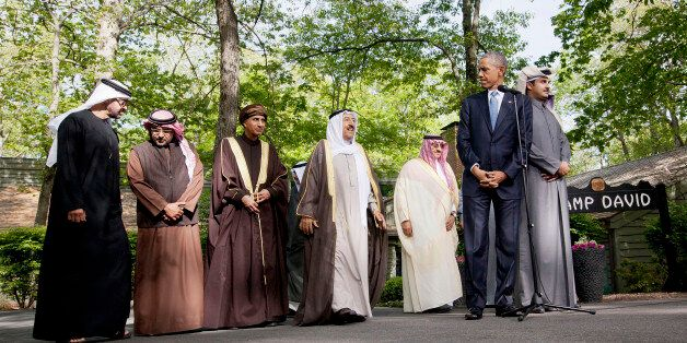 President Barack Obama, center, waits for  from left, Abu Dhabi crown prince Sheikh Mohammed bin Zayed Al Nahyan; Bahrain Cro