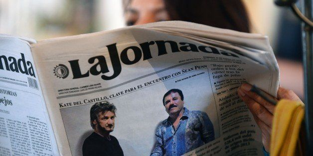 TOPSHOT - A woman reads La Jornada newspaper in Mexico City, on January 10, 2016 which shows a picture of drug lord Joaquin G