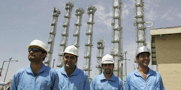 Arak, IRAN:  Iranian employees pose for a picture at the newly opened heavy water plant in Arak, 320 kms south of Tehran, 26