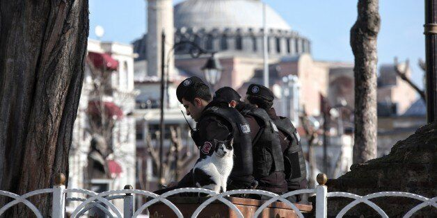 ISTANBUL, TURKEY -  JANUARY 12: Turkish police secure the area after an explosion in the central Istanbul Sultanahmet distric