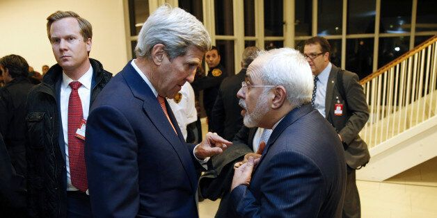 US Secretary of State John Kerry (L) speaks with Iranian Foreign Minister Mohammad Javad Zarif after the International Atomic