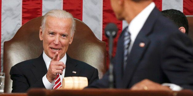 FILE - In this Jan. 12, 2016 file-pool photo, Vice President Joe Biden points at President Barack Obama during the president'