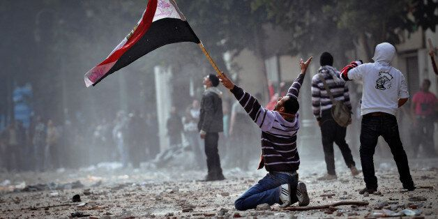 [UNVERIFIED CONTENT] CAIRO, EGYPT - DECEMBER 16: An Egyptian protester on his knees during clashing with army soldiers inside