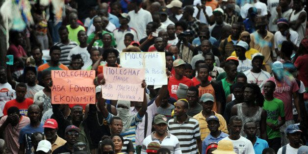 Protesters march in Port-au-Prince on January 24, 2016 to demand the resignation of Haitian President, Michel Martelly.  Hai