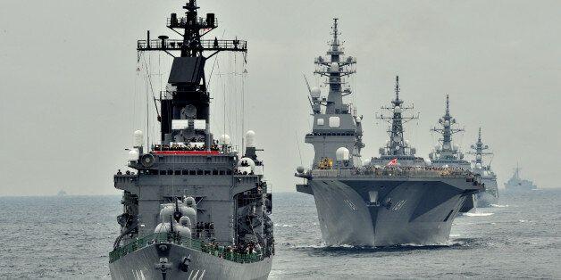 Japan Maritime Self-Defence Force escort ship Kurama (L) sails during their 2012 navy fleet review off Sagami Bay, Japan's Ka
