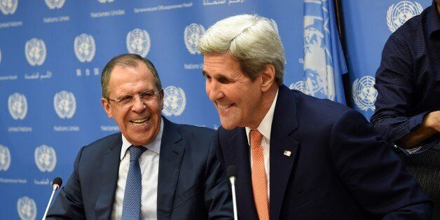 Foreign Minister of Russia Sergey Lavrov (L) and US Secretary of State John Kerry  hold a news conference after a UN Security