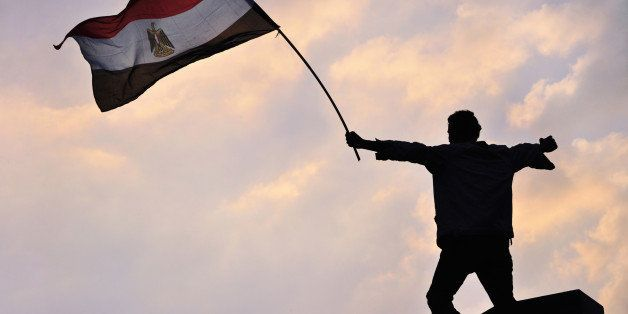 [UNVERIFIED CONTENT] CAIRO, EGYPT - FEBRUARY 8: An Egyptian protester waves the Egyptian flag during protests in Tahrir Squar