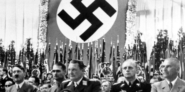 German Minister of Propoganda Dr. Joseph Goebbels, unseen, intoduces German Chancellor Adolf Hitler, left, to the large audie