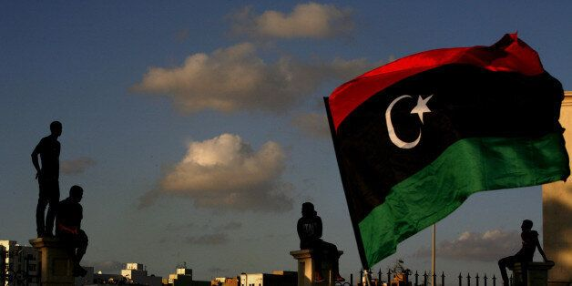 Libyans watch the protest against Ansar al-Shariah Brigades and other Islamic militias, in Benghazi, Libya, Friday, Sept. 21,