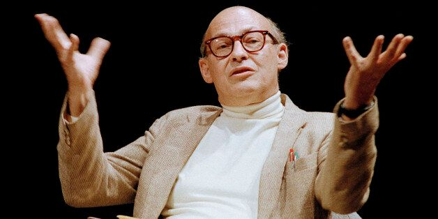 """FILE - In this July 14, 1987, file photo, Massachusetts Institute of Technology's Marvin Minsky, speaks to the audience during a panel discussion whose topic was, """"Artificial Intelligence: Society's Atlas or Achilles,"""" at the Paramount Theater in Seattle. A pioneer in the field of artificial intelligence at MIT who saw parallels in the functioning of the human brain and computers has died. The university said Minsky died Sunday, Jan. 24, 2016, at Brigham and Women's Hospital in Boston of a cerebral hemorrhage. Minsky was 88. (AP Photo/Robert Kaiser, File)"""