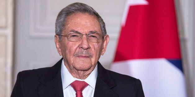 Cuban President Raul Castro attends an agreements' signing ceremony with French President Francois Hollande during a meeting