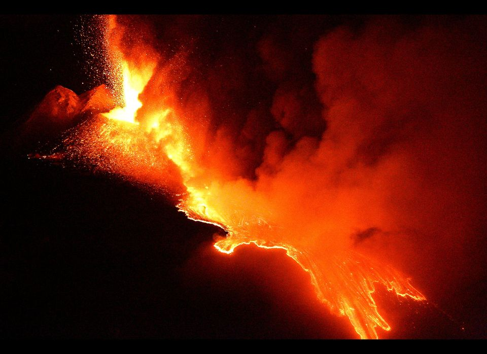 Lava spewed from a crater of the giant Etna volcano in the southern Italy island of Sicily on July 30, 2011 near Catania. The