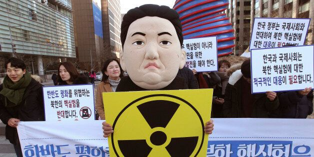 A South Korean university student wearing a mask depicting North Korean leader Kim Jong Un participates in a rally against No